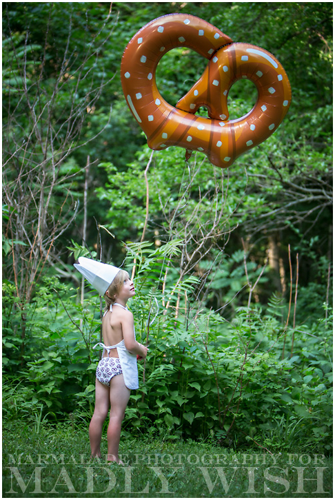 Photo of a boy holding a pretzel balloon wearing Madly Wish underwear