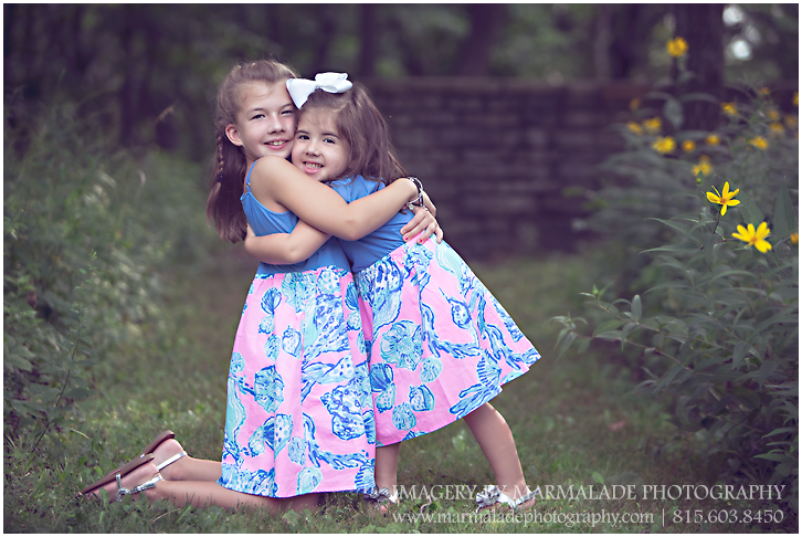 Two sisters in a natural outdoor setting during a photo session