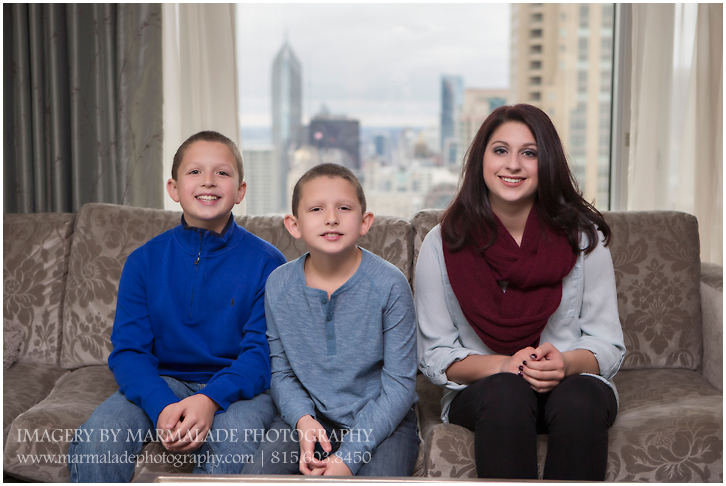 A photo of a set of three siblings in the Four Seasons Hotel, Chicago, IL