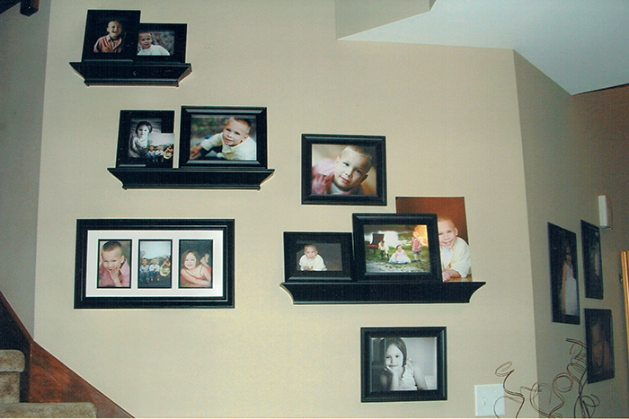 A client provided photo of their wall display filled with Marmalade Photography photos
