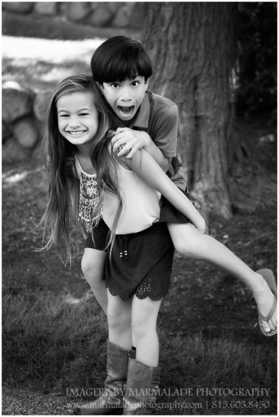 Photo of two siblings having fun at a photo session in Chicago