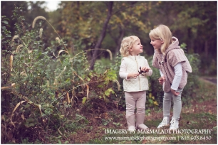 An example of a photograph of young sisters in the fall