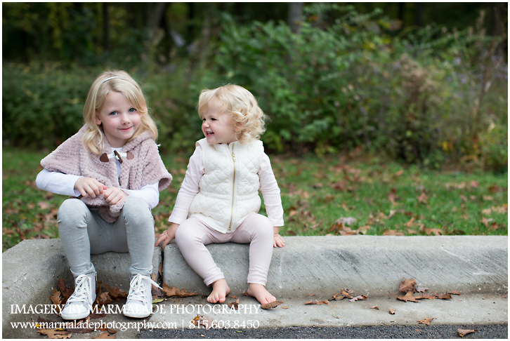 An example of a fall photo of two young sisters