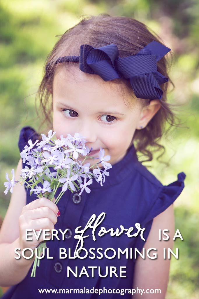 photograph of a Mokena, IL girl holding a flower